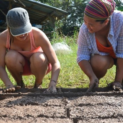 Gap year student in Thailand planting seeds