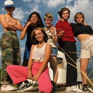Six teenagers participating in a wilderness gap year have fun posing for a group photo.
