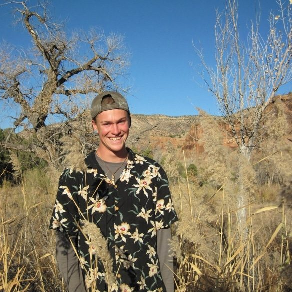 Young man smiling wearing floral shirt in Colorado desert
