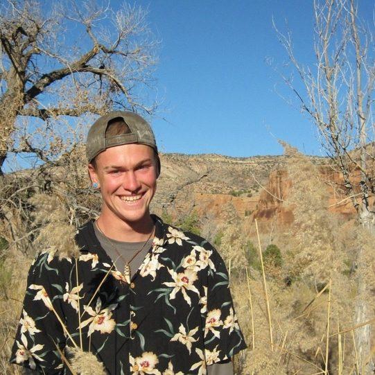 Young man smiling wearing floral shirt in Colorado desert