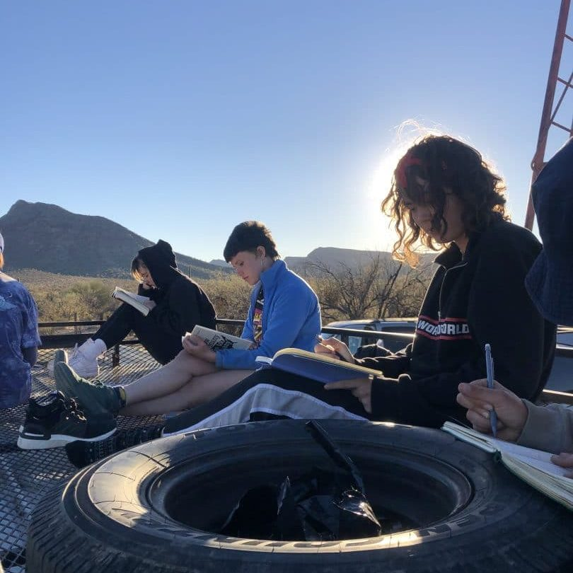 Students studying in the desert