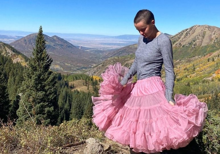 young woman in the mountains wearing a tutu
