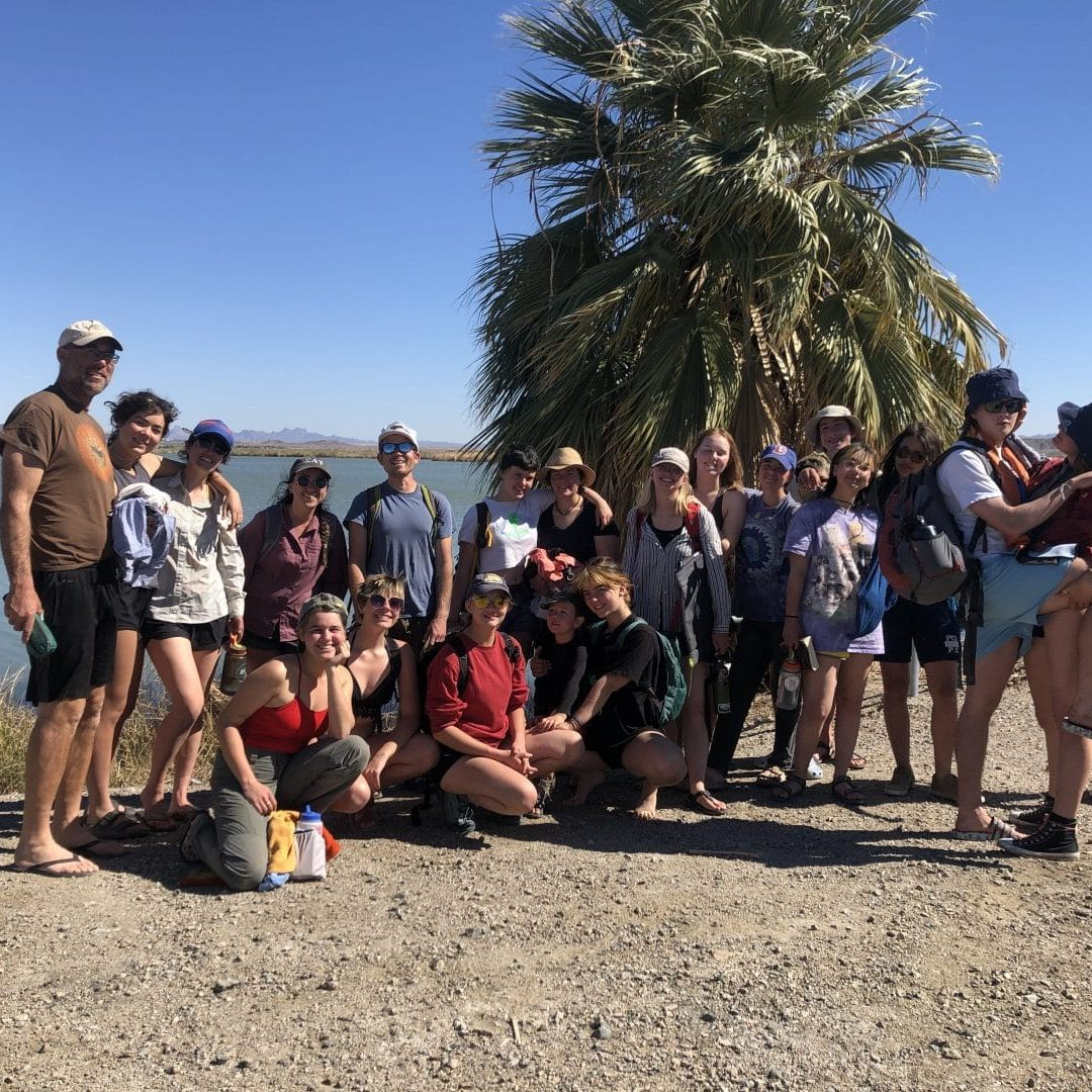 student group gathered in front of the Colorado River