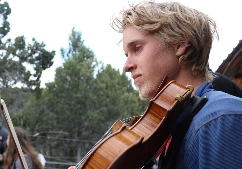 young man playing fiddle